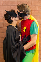 Batman and Robin - Quebec City Comic-Con 2015 (Irrational Photography) Tags: quebec canada canon slr dslr 5d mark iii digital photo picture lens batman robin cosplay gender play genderplay comic con comiccon comicon wall brick kiss costume movie 60 60ies 60s television series adam west burt ward kissing love loving red yellow green retro natural light 2015 feminism irrational photography