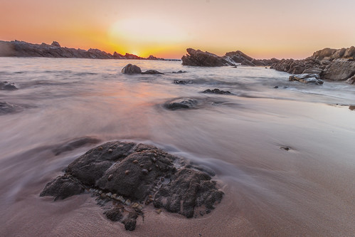 Sunset on a rocky beach