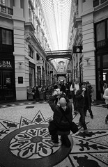 2015-11-27 DenHaag_F De Passage. The Netherlands. © RESPECT the copyright 19-09-2015 (YoLeenders) Tags: people thenetherlands streetphotography rangefinder architectuur atmophere nikoncoolscan5000ed analogblackandwhite delta100asa leicam6ttl072 elmaritm12821mmasph developerhc110131b thehaguedepassage