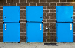 Welcome to the playground. (solalta) Tags: brick blue wall barred locked three door