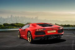 Even the world is moving around you. Aventador. (Nike_747) Tags: naksphotographydsign even world is moving around you aventador lamborghini lp7004 lp7404 coupe roadster supercar hypercar super hyper car sportscar sport class exotic rare luxury color auto facelift limited edition pure gold scarlet red v12 v 12 italy italian bull black carbon fibre green trees bushes town city earth sky clouds movement circling triple exhaust pipes