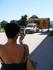 Nina in Vukovar, summer 2016 (sean and nina) Tags: nina vukovar croatia hrvatska balkans balkan europe eu european serb woman female girl lady girlfriend fiancee wife married blue dress summer 2016 brunette dark brown hair long sunglasses candid unposed outdoor outside people person vacation tourist face mouth pink lips throat neck bare skin arms legs tan tanned sunny beauty beautiful gorgeous stunning charming charm happy back backless straps shoulders camera photographer