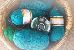 Knitting Basket and Camera (rolandmks7) Tags: sonynex5n basket knitting camera yarn teal green apsfilmcamera canon elph ixus ixy aps fujinon 55mm f18 fade lensflair