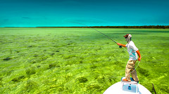 The art of fishing in Key Biscayne (The Sergeant AGS (A city guy)) Tags: fishermen fishing navigating sea seascape sport waterways miamifl people boats