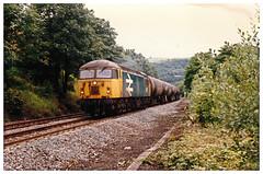 56127 On Tanks, Calder Valley, West Yorkshire. (ManOfYorkshire) Tags: 56127 class56 britishrail railblue largelogo tanbks tankers rain railway westyorkshire caldervalley hebdenbridge pennines freight diesel locomotive hills pennine bogie