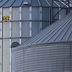 Silos: No 3 (llawsonellis) Tags: linear silos rural steel corrugated sign text gsi yellow grey violet blue black texture pattern patterns repetition repetitions diagonals duct curves shadows outdoors mundane square squareformat texturesquared fragment abstract abstraction abstractsquared minimal minimalistic minimalism crop selectedabstract