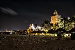 Palm Beach evening (mystero233) Tags: beach palmbeach palm palmtrees aruba onehappyisland island riu hotel hotels sunshade sand bar night evening longexposure windy light outdoor sky dark dawn caribbean holiday