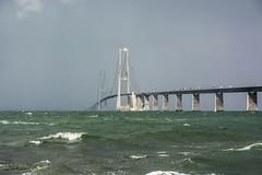 The bridge into the sea (Leonardo Piccioni) Tags: bridge sea sky sun rain clouds denmark europe nuvole ponte sole pioggia danimarca cieolo d7100 nikkor1685 nikonclubit