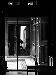 looking through an old home - b+w (SM Tham) Tags: light fan town interiors doors shadows furniture townhouse courtyard unescoworldheritagesite vietnam hoian motorbike doorways partitions