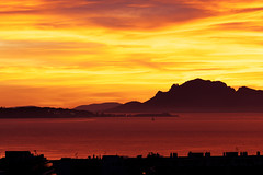 French riviera sunset - in explore - (Nicolas Bousquet) Tags: sunset red sea orange mer yellow jaune rouge ctedazur explore crpuscule litoral antibes saintemarguerite couchdesoleil esterel frenchriviera f135 romanticsunset 50shadesoforange
