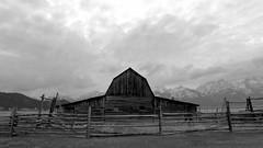 John Moulton's Barn (ramislevy) Tags: mormonrow antelopeflats grandtetons wyoming jackson barn gambrel clouds fence homestead grosventre