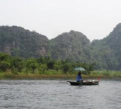 Solo boat (program monkey) Tags: river trangan vietnam boat row umbrella ninhbinh