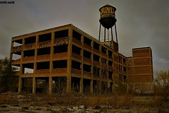 Abandoned under a cold November sky (Explore!) (SCOTTS WORLD) Tags: adventure abandoned architecture america angle sky shadow stormy ruin rainy clouds detroit digital decay dilapidated windows weathered watertower urban usa unitedstates urbex urbanexploring urbandecay graffiti atmosphere panasonic pov perspective parking november 2016 detail building blight 313 exploring empty fun fall michigan motown midwest motorcity