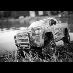 Big is Relative (johnny.barker) Tags: toy truck size mud pond black white bw perspective