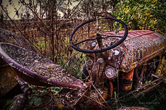 Old Age Spots (jackalope22) Tags: tractor lichen spots rust decay