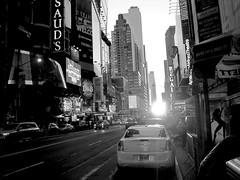 Titan 2013 (Greyframe) Tags: 100 nyc ny new york downtown manhattan street crazy blackandwhite monochrome black white greyframe grey photography blackwhite bw blwh schwarz weiss schwarzweis sun down sundown broadway usa car taxi titan lady ad