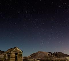Rhyolite-108.jpg (Travis Fike) Tags: lightpainting night landscape outdoors starpoints deathvalley architecture environment wideangle stars longexposure rhyolite