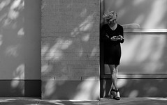 Windy Day Smoke (burnt dirt) Tags: houston downtown mainstreet texas windy hair girl woman cigarette smoking bw