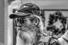 Easy Rider (KC Mike D.) Tags: portrait streetphotography man harleydavidson hat ball cap patch usa beard wiry hair candid street