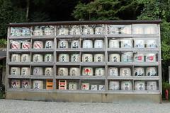 Nachi Grand Shrine 32 (Geoff Buck) Tags: japan shrine sacred buddhism buddhist temple buidling tree kumanokodo kumano nachi nachisan shinto worldheritagesite pilgrim pilgrimroute history worship statue statues carvings flags altar