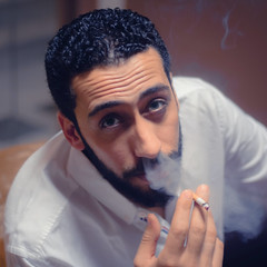 Blue Smoke (EEAworkshop) Tags: portrait indoor people man smoke cigarette smoking model guy beard fashion style menswear men arabic arab arabian beauty handsome hand light naturallight dof bokeh white shirt green eyes closeup detail face indoors friends square squareformat colors red purple colorful color nikon 50mm d90