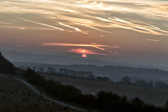 Scarred Sky - A Winters Sunrise (Andi Hardman) Tags: winter sunrise red sun danebury hill fort hillfort sky clouds vapour trail vapor fog mist countryside view scarred