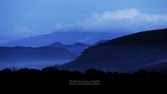 Misty Lands (Rooru S.) Tags: blue mist mountain clouds landscape lowlight sony a850 dslra850 sal70400g2