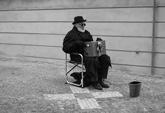 The x (ludovicapalumbo) Tags: street old people music man black art hat wall architecture loneliness prague praga x silence individual
