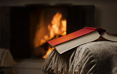 Peaceful and warm image of a open book by fireplace. (ryandouglas2) Tags: downshifting blanket book burning closeup cloth color comfort comfortable cosy couch cozy dark downshift fire fireplace glow home horizontal indoor indoors interior leisure lifestyle literature open read reading red relax resting seasonal serene serenity sofa tranquil tranquility warm wood finland