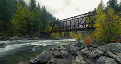 Fall along the Wenatchee river. (Brendinni) Tags: fallcolors fall wenatcheeriver eawa trees water flow bridge architecture pipeline rocks river pnw landscapes