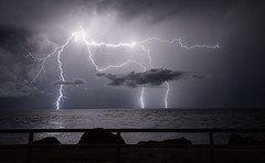 Danger on the Rocks (Bobby Wummer) Tags: lightning thunderclouds thunderstorms thunderstorm weather storms stormchaser stormchasing oceanstorm ocean oceanscape outdoors nightphotography longexposure nightscape night