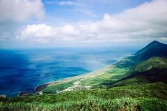 Tail of Lanyu (hiphopmilk) Tags: nikonfm2n nikonfm2 nikon fm2 35mm 135film film analog analogue kodak nikkor jaredyeh hiphopmilk taiwan lanyu orchid island pongso no tao yami ivalino sea ocean sky cloud blue tail mountain green