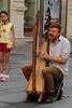 Cosmopolitan empire (Animusanima) Tags: vienna wien travel music playing austria österreich cosmopolitan child singing song eruope instrument harp streetmusic curiosity meltingpot irishman hallelujah passingby
