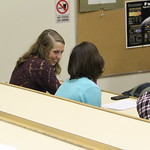 Students discuss a presentation in Phillips Lecture Hall.