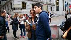 (heatherbirdtx) Tags: street portrait newyork color couple availablelight candid strangers tourist spanish guidebook