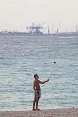 Selfie stick and boy (Iker Merodio   Photography) Tags: boy beach spain community pentax stick tamron castello benicassim selfie 70300 hondartza k50 valencian mutil