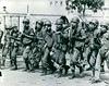 1965 Marching soldiers, wearing M17 gas mask, during Vietnam war. 2-3-65