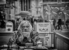 Tea and cigarettes (Daz Smith) Tags: dazsmith canon6d bw blackwhite blackandwhite bath city streetphotography people candid canon portrait citylife thecity urban streets uk monochrome blancoynegro mono man bearded cigarette smoking tea drinking flock birds flying