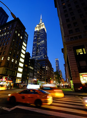 Empire State Building in New York (` Toshio ') Tags: toshio nyc newyork newyorkcity manhattan city taxi cab midtown america bluehour usa street crosswalk fujixe2 xe2 car traffic building architecture blur motion