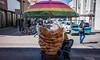 2016 - Mexico - San Luis Potosi - Pork Rind (Ted's photos - For Me & You) Tags: 2016 cropped mexico nikon nikond750 nikonfx sanluispotosi tedmcgrath tedsphotos tedsphotosmexico vignetting streetscene street people peopleandpaths umbrella porkrind streetsales bicycle shadow bollard