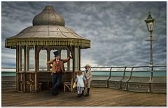Waiting for momma (Hugh Stanton) Tags: appickoftheweek victorian pier reinactors lampost gas