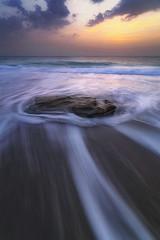 Resistance (Waheed Akhtar Photography) Tags: beach beachphotography seascape seascapephotography sea sunrise landscape landscapephotography rock waves clouds sky land canon travel fujairah uae unitedarabemirates exploreuae light shadows waheedakhtar
