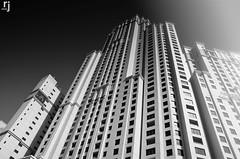Jumeirah Beach Residence Tower, Dubai (RJ-Clicks) Tags: dubai uae emirates marina marinabeach jumeirahbeach tower jbr jumeirahbeachresidence sun glare bw architecture windows