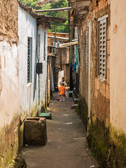 Playing in the alley (D Song) Tags: old city travel blue sunset brazil sky panorama playing mountains streets green church architecture kids buildings children churches panoramic historic cobblestone vista belohorizonte hilly favela ouropreto slums