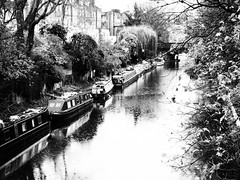 Regents Canal on a Rainy Day (cycle.nut66) Tags: trees winter blackandwhite white black reflection london art film water monochrome rain boat canal drops olympus rings filter rainy grainy grayscale narrow narrowboat regents evolt epl1 microfourthirds mzuiko