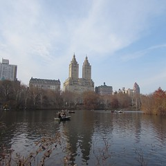 Central Park December Rowboats (SplashH2O) Tags: park city nyc newyorkcity trees two sky people newyork reflection building water skyline buildings boats december day centralpark central row boating rowing iloveny ilovenewyork onthewater unseasonablywarm itsalovelydaytoday