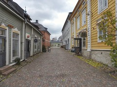 I love cobblestones under my feet (KaarinaT) Tags: cobblestones street oldtown porvoo oldtownporvoo oldwoodenhouses colorfulwoodenhouses empty emptystreet finland suomi shops boutiques cafe oldtimecharm picturesque charming