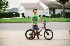 My Prince (Joel Vergara Photography) Tags: sonya7 ilce7b novoflexadapter nikon5012ais bicycle portraitchildrennatural mirrorlesscamera sonymirrorlesscamera
