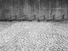 Bicycle rack (schauplatz) Tags: bayerischerwald bayerwald deutschland lamerwinkel urlaub cham fahrradstnder bicyclerack bikerack kopfsteinpflaster hell schatten