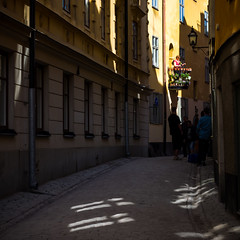 The Balcony (Jens Haggren) Tags: street balcony light windows people city gamlastan oldtown stockholm